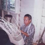 Blind Handicraft Trainer demonstrating Weaving Technique