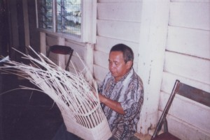 Blind Handicraft Trainer demonstrating Weaving Technique