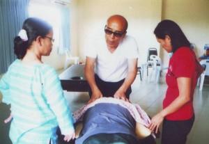 Massage Trainer from overseas demonsting massaging technique